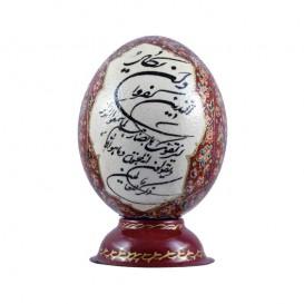 آیه «و ان یکاد...» بر روی تخم شترمرغ - قرمز